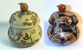 "Two lidded porcelain ginger jars by Domine's Collections. Size: 8"" H x 6"" Dia."