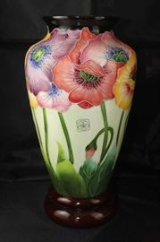 "McCall J. with original box. Icing on the cake, 14"" Poppy Vase with wood base."