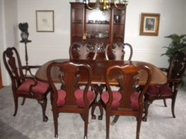 Drexel Travis Court 51″ Bow FrontChina Cabinet & Ethan Allen 18th Century Mahogany Dining Table with banded parquetry & The feet are capped with solid brass.
