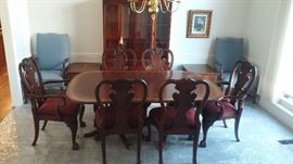 Drexel Travis Court 51″ Bow Front China Cabinet & Ethan Allen 18th Century Mahogany Dining Table with banded parquetry & The feet are capped with solid brass.