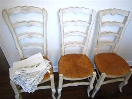 There are 6 of these ladderback chairs for sale.