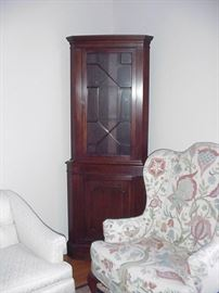 Mahogany corner cabinet; wing chair