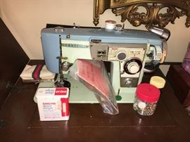Vintage Brother sewing machine with cabinet.