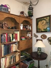 Two pressed wood bookcases and decor.