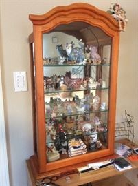 Collection of cats, curio cabinet