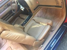 Interior shot of the original Leather Tan seats and color coordinated flooring.