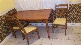 Wood kitchen table with 6 chairs (2 not pictured). Great for a starter home!