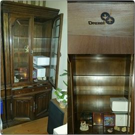 Drexel Wall Unit, piece #2 of 3. Has glass shelving and doors, one drawer and enclosed cabinet at bottom for storage. Can purchase individually or all three pieces.