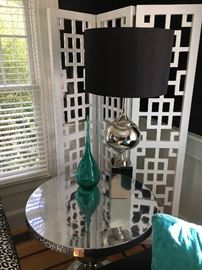 These versatile chrome tables are a wonderful accent. Add to that this sleek table lamp with chrome base -- behind that is a fab architectural room divider that adds tremendous interest!