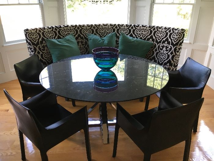 This luxury dining table features a chrome base and a beautiful, huge slab of black and white marble.  The Mario Bellini Leather cab chairs are in perfect condition and add such elegant style.
