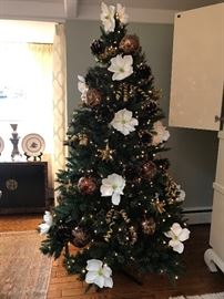 7 1/2' pre-lit Christmas tree.  Ornaments & decor sold separately