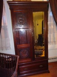 Antique Carved Armoire