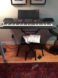 casio keyboard, chair, pedal and music stand