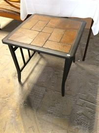 Tile and wrought iron table