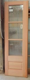 Pair of custom mahogany doors with rain glass