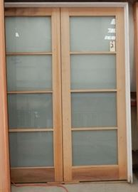 Pair of custom doors in frame with milk glass lights