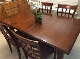 Dining room table with leaf and five chairs.