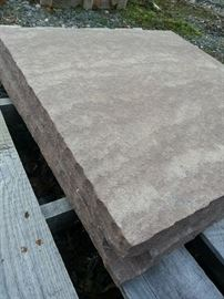 Natural stone caps, pavers, and treads, available up at the business.