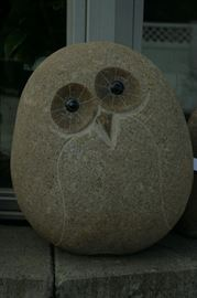 Granite owl and other statuary available at business.