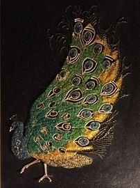 Beautiful peacock on black velvet
