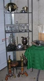 Waterford crystal stemware, antique copper and brass andirons with lion faces, silverplated serving pieces.