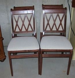 Awesome wood folding chairs with upholstered cushioned seats, perfect for holiday guests!