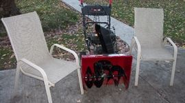lawn chairs and snowblower
