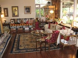 Front living room with large Oriental style carpet, brass and glass coffee table , brass and glass cart