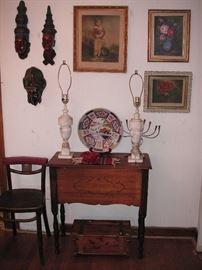 Table with shelf on back side; vintage restaurant chair; Bali masks