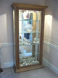 Pulaski curio cabinet with mirrored back and contents.