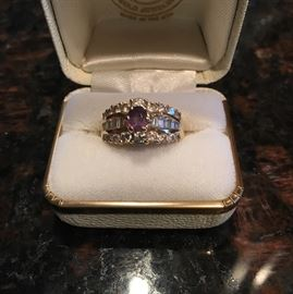 18 ct. gold Alexandrite and diamond ring.  18 round diamonds/12 baggets.  ASK to see this ring.