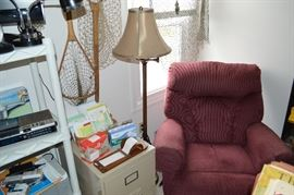 comfortable recliner and great old fishing nets