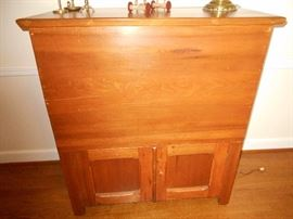 Blanket chest with door opening bottom. Very unusual.