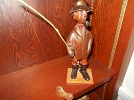 Whimsical wooden fisherman. This is my fishing luck... bringing an old shoe!