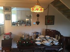 Tiffany style hanging lamp.  Silver Tea Service w/tray. Older Czech Fine China Set. Dark Wood Dining Room Table with built in leaf w/4 matching chairs. Medicine cabinet. Wooden child's school desk.