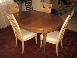 Dining room table with one leaf in...one more extra and pads