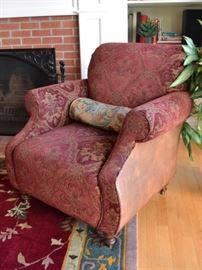 Upholstered armchair with leather sides and back
