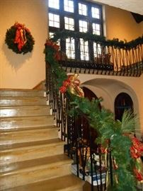 Foyer:  The steps are stone and lead up to the second floor.  This is the beginning of about 60+ feet of greenery that we used to decorate the railing.  It is for sale and was originally purchased at THREE FRENCH HENS.