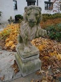 "Entrance:  One of a pair of lions greets you with his paw up in a friendly gesture.  The lions are priced as a pair.  Each is two pieces and stands 34"" tall."