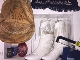 Cowboy boots, leather bags and cut crystal