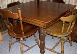 Sturdy square oak table has thick turned legs.  Assorted side chairs