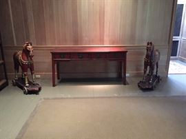 Pair of carved wooden horses and an antique Asian sideboard
