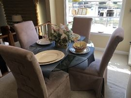 Lovely Glass Top table with four upholstered chairs