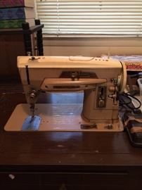 #34 singer sewing machine in case $35