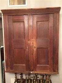 Primitive wall cupboard with shelves