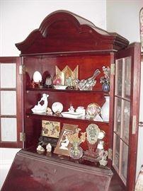 Interior of secretary holds many treasures