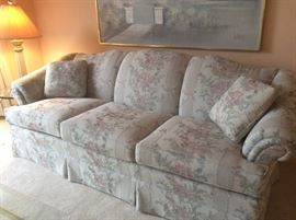 Floral upholstered sofa, one of a pair