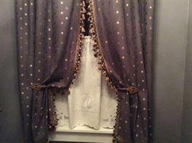 Slate linen lined, tassel fringed curtains