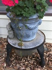 Wrought Iron Base w/rollers + Concrete Planter