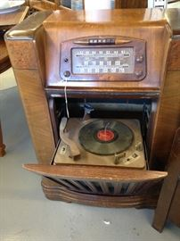 Wonderful 1940's Radio and Turntable.  Turns on.  al tubes there...needs TLC. Beautiful cabinet